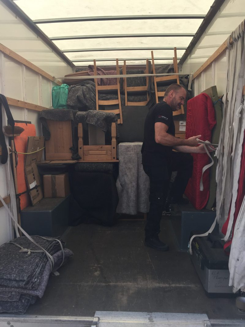 Strapping a load inside a removal van