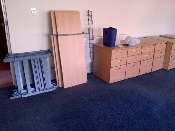 Flat packed desks ready to be moved