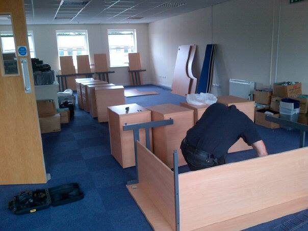 man assembling office furniture