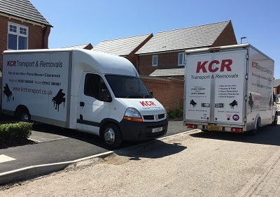 Two KCR removals vans
