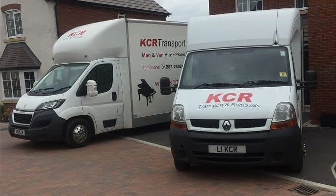 Two removals vans ready to load