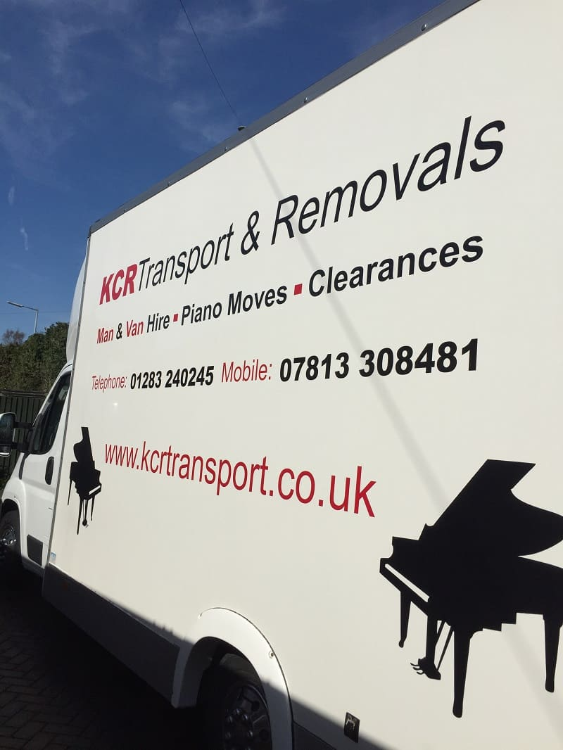 The side of a KCR Transport removals van